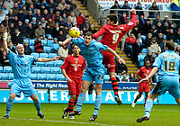 Photo: Ed Godden/Sportsbeat Images.<br />Coventry City v Cardiff City. Coca Cola Championship. 10/02/2007. Coventry's Colin Hawkins (no. 20) and Steven Thompson (no. 9) collide as the Cardiff player heads the ball just wide of the goal.