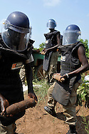 Deminers from Mines Advisory Group (MAG) prepare the controlled demolition of a BM-1 Katyusha rocket and many other unexploded ordinace (UXO) that they cleared from an area around a former military barracks and weapons store used by northern government forces during Sudan's civil war. The building is next to an open area near the John Garang memorial where Independence ceremonies will be held on July 9th, 2011. The area is heavily contaminated with unexploded ordinance (UXO). The Government of South Sudan asked MAG to help SPLA deminers clear the area before the independance celebrations..Nyamini, South Sudan. 05/07/2011..Photo © J.B. Russell