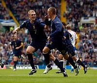 Photo: Jed Wee.<br />Scotland v Faroe Islands. European Championships 2008 Qualifying. 02/09/2006.<br /><br />Scotland's Darren Fletcher (L) congratulates penalty scorer Kenny Miller.