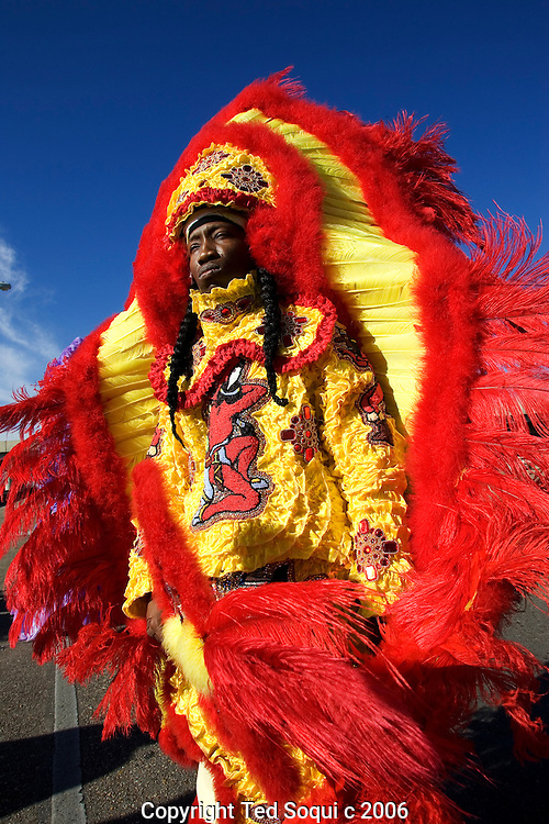 A Mardi Gras Indian posing on the I10 overpass. They are very flamboyant as they roam New Orleans neighborhoods in small bands lead by a Chief during Mardis Gras day..Mardis Gras six months after hurricane Katrina damaged much of New Orleans. The city is still empty in the lower 9th and ward and St. Bernards Parish, but many of the cities residents came back to participate and celebrate..