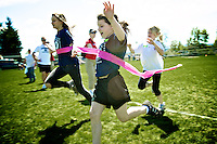Rheana Pollos crosses the finish line of the 50-yard dash in first place during the Borah Elementary track and field day events Thursday, May 19, 2011 in Coeur d'Alene, Idaho. Rheana also competed in the 100-yard dash where she placed third.