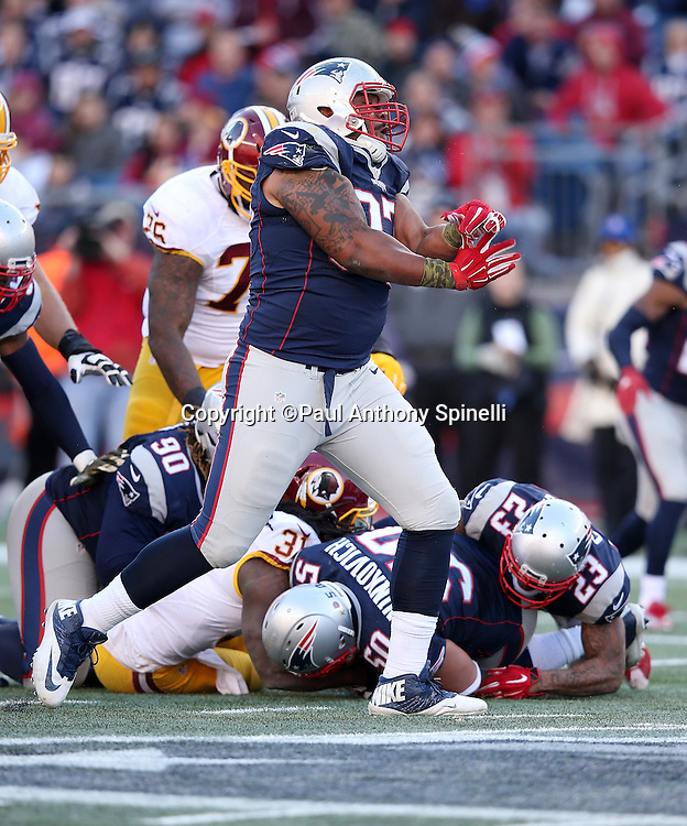 New England Patriots defensive tackle Alan Branch (97) celebrates after causing a third quarter fumble recovered by New England Patriots defensive end Rob Ninkovich (50) during the 2015 week 9 regular season NFL football game against the Washington Redskins on Sunday, Nov. 8, 2015 in Foxborough, Mass. The Patriots won the game 27-10. (©Paul Anthony Spinelli)