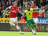 Mesut Ozil of Arsenal and Nathan Redmond of Norwich in action during the Barclays Premier League match at Carrow Road, Norwich<br /> Picture by Paul Chesterton/Focus Images Ltd +44 7904 640267<br /> 11/05/2014
