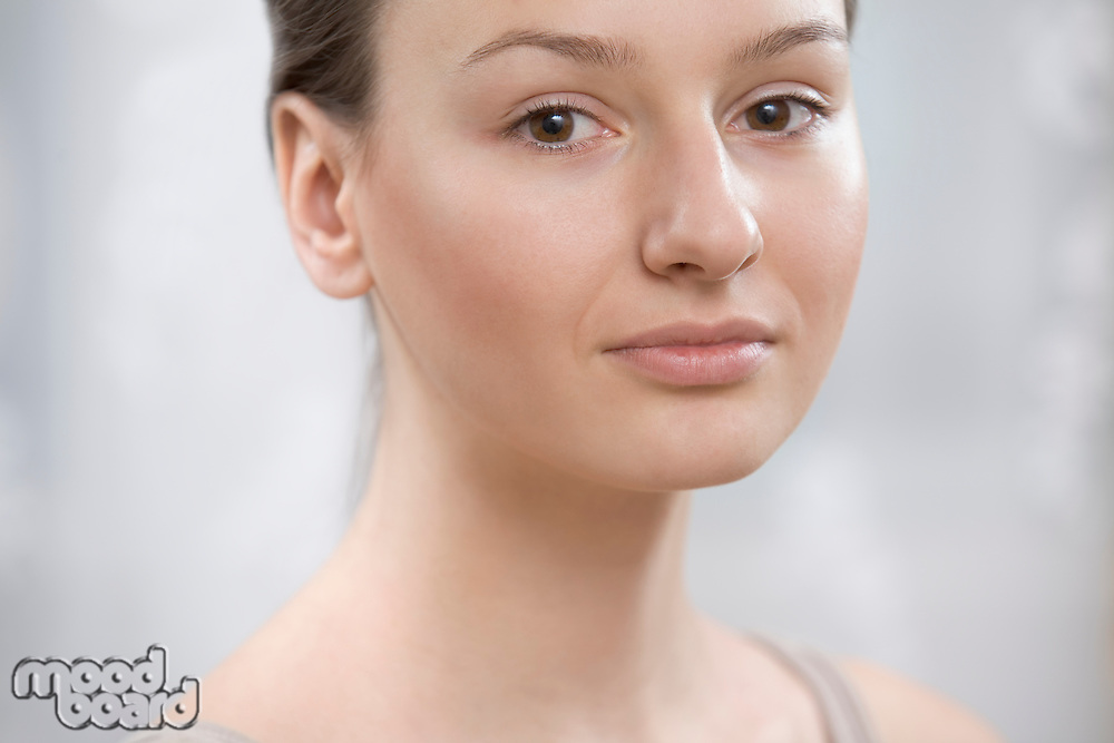 A close up of a young womans face
