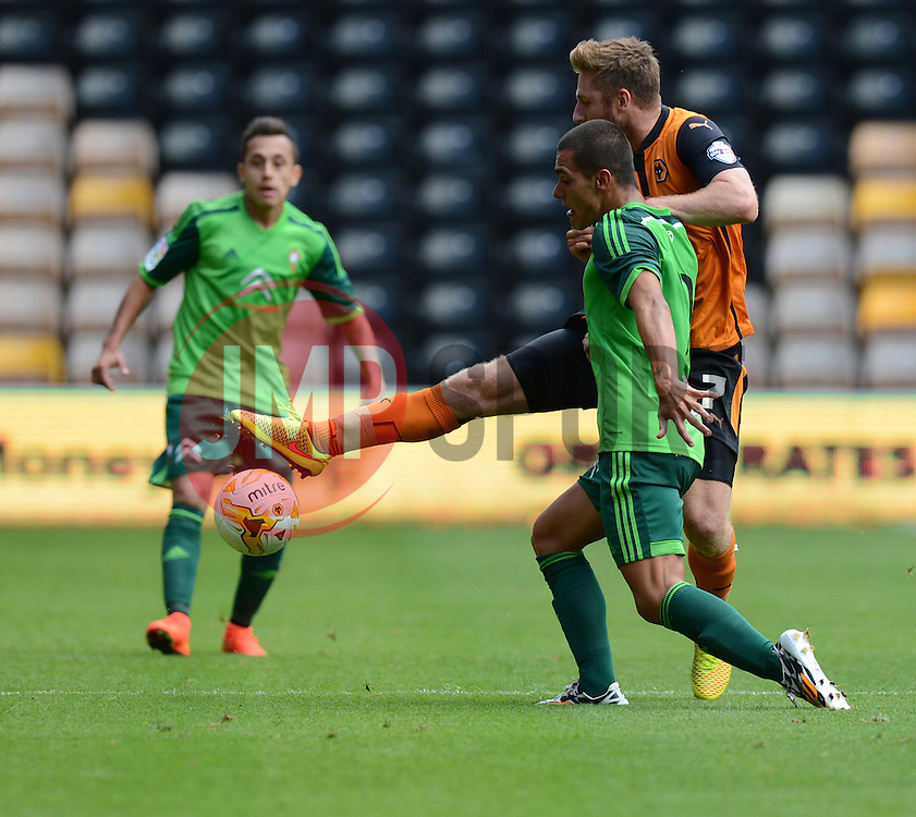 Wolverhampton's James Henry wins the ball from Celta Vigo's Andreu Fontas  - Photo mandatory by-line: Alex James/JMP - Tel: Mobile: 07966 386802 2/08/2014 - SPORT - FOOTBALL - Bristol - Memorial Ground  -   Wolverhampton vs  Celta Vigo - preseason