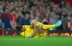 LONDON, ENGLAND - Saturday, September 20, 2014: Liverpool's Fabio Borini injured during the Premier League match against West Ham United at Upton Park. (Pic by David Rawcliffe/Propaganda)