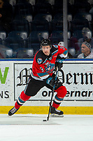 KELOWNA, BC - NOVEMBER 20: Sean Comrie #3 of the Kelowna Rockets skates from behind the net with the puck against the Victoria Royals at Prospera Place on November 20, 2019 in Kelowna, Canada. (Photo by Marissa Baecker/Shoot the Breeze)