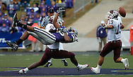 Texas A&M safety Jaxson Appel, right, reaches for the ball after linebacker Justin Warren broke up a pass intended for Kansas State's Jesse Martinez in Manhattan, Kansas.