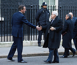 © London News Pictures. 16/01/2012. London, UK. British Prime Minister David Cameron (Left) meeting Palestinian President Mahmoud Abbas (Right) outside 10 Downing Street in London today (16/01/2012). President Mahmoud Abbas will visit  London, Berlin and Moscow to talk to members of the so-called Quartet of peacemaking powers pressing him to restart negotiations with Israel. Photo credit : Ben Cawthra/LNP