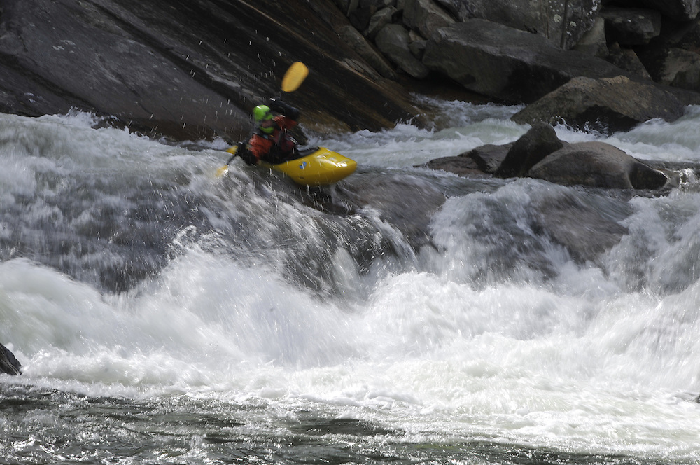 White water kayakers brave class IV rapids like Thunderhole and 10-foot Falls at Wilson Creek river near  Morganton, NC.