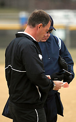30 March 2013:  Steve King reviews some lineup changes with Umpire Jay MacDaniels of Pekin IL during an NCAA Division III women's softball game between the DePauw Tigers and the Illinois Wesleyan Titans in Bloomington IL