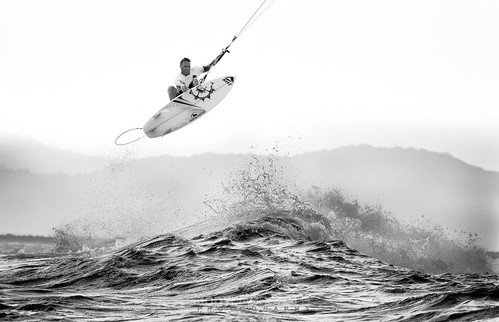 Pro kiteboarder Ben Wilson flicks a nice air off a wave in Indonesia