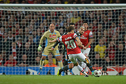 LONDON, ENGLAND - Oct 01: Arsenal's midfielder Mathieu Flamini from France takes a shot at goal during the UEFA Champions League match between Arsenal from England and Napoli from Italy played at The Emirates Stadium, on October 01, 2013 in London, England. (Photo by Mitchell Gunn/ESPA)