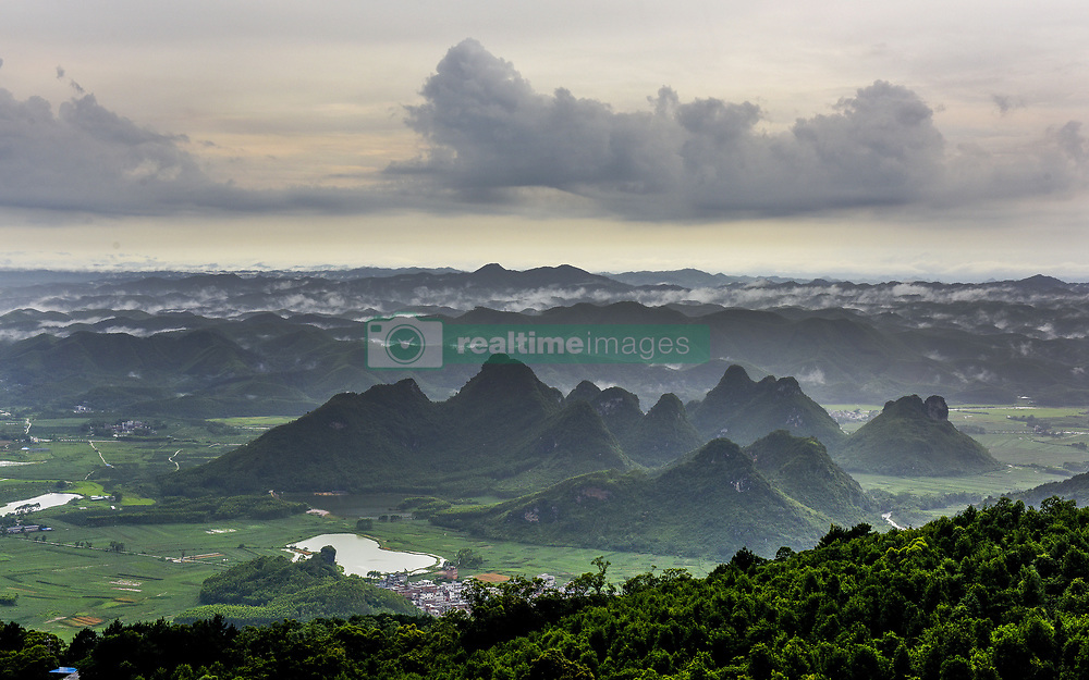 July 4, 2017 - China - Guangxi, CHINA-June 29 2017: (EDITORIAL USE ONLY. CHINA OUT)...Mist blankets Daming Mountain after heavy rain in southwest China's Guangxi. (Credit Image: © SIPA Asia via ZUMA Wire)