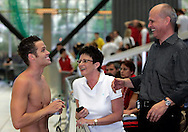 SCUW's Dominik MEICHTRY (L) of Switzerland talks to his mother Yvonne (C) and his father Richard (R) after achieving the Swiss Olympic standard for the men's 200m freestyle on the first leg in the men's 4x200m freestyle relay at the Swiss Swimming Championships in Geneva, Switzerland, Thursday, April 3, 2008. (Photo by Patrick B. Kraemer / MAGICPBK)