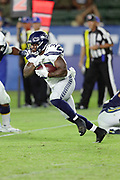 Seattle Seahawks running back Mike Davis (39) runs the ball during the 2017 NFL week 1 preseason football game against the against the Los Angeles Chargers, Sunday, Aug. 13, 2017 in Carson, Calif. The Seahawks won the game 48-17. (©Paul Anthony Spinelli)