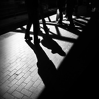 Silhouettes and shadows of legs in a stadium