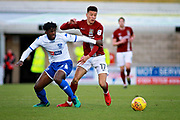 Northampton Town midfielder Shaun McWiliams (17) and Bury Town defender Greg Leigh (3) during the EFL Sky Bet League 1 match between Northampton Town and Bury at Sixfields Stadium, Northampton, England on 25 November 2017. Photo by Nigel Cole.