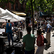 """June 21, 2014 - New York, NY : <br /> The city was flooded with music on Saturday as Make Music New York brought more than 1,300 free concerts to the city's streets and parks. The annual festival's program included the performance """"'In (Key)' - New Compositions in Celebration of Terry Riley's 'In C' @ 50 Years"""" on Cornelia Street, in front of the Cornelia Street Cafe in Greenwich Village, on Saturday afternoon.<br /> CREDIT: Karsten Moran for The New York Times"""