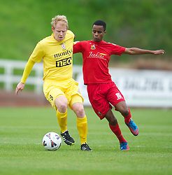 LLANELLI, WALES - Saturday, September 15, 2012: Newtown's captain Matty Cook in action against Llanelli's Mamadou Diallo during the Welsh Premier League match at Stebonheath Park. (Pic by David Rawcliffe/Propaganda)