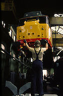 Slinger guiding a crane driver as he lifts a diesel locomotive. British Rail Engineering Ltd, Doncaster.....