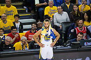 Golden State Warriors guard Stephen Curry (30) watches gameplay against the Houston Rockets from the sidelines during Game 3 of the Western Conference Finals at Oracle Arena in Oakland, Calif., on May 20, 2018. (Stan Olszewski/Special to S.F. Examiner)
