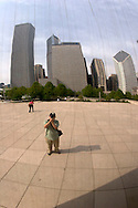 Self-Portrait Reflection of Photographer Richard Wong and Chicago Skyline on the Cloud Gate on AT&T Plaza in Millenium Park, Chicago, Illinois