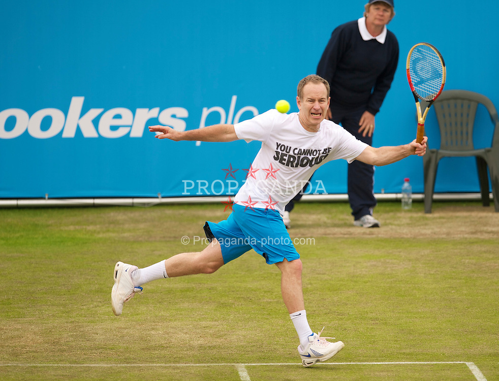 LIVERPOOL, ENGLAND - Friday, June 18, 2010: John McEnroe (USA) in action during the Mixed Doubles on day three of the Liverpool International Tennis Tournament at Calderstones Park. (Pic by David Rawcliffe/Propaganda)