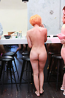 Nudists relaxing and having drinks, after a tour of the Palais de Tokyo Art Museum in Paris<br /> <br /> relaxing at the bar for a drink after the tour<br /> <br /> May 5, 2018<br /> <br /> Photograph by Owen Franken for the NY Times
