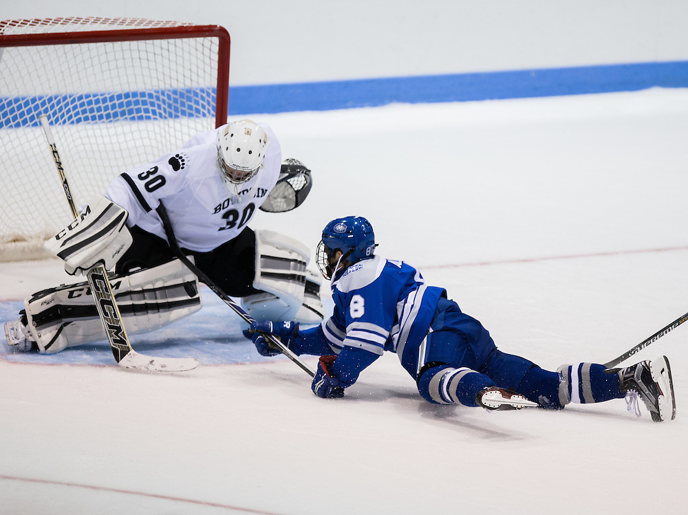 Colby College Forward Devin Albert  (8) puts a shot on Bowdoin College Goalie Peter Cronin (30) during a NCAA Division III hockey game between Colby College and Bowdoin College on December 5, 2015 at Sidney J. Watson Arena on the campus of Bowdoin College in Brunswick, ME.  (Dustin Satloff)