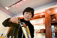 24 October, 2008. New York, NY. Owner Namhee Girerd Kim, 53, picks an assortment of bon bons and fills a small bag at the boutique &quot;L'atelier du chocolat&quot;. The chocolates are made by her husband, Eric Girerd.<br /> NOTE: Since no customers were at the shop, the subject posed for the photographer.<br /> &copy;2008 Gianni Cipriano for The New York Times<br /> cell. +1 646 465 2168 (USA)<br /> cell. +1 328 567 7923 (Italy)<br /> gianni@giannicipriano.com<br /> www.giannicipriano.com