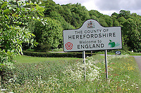 Welcome to England sign on the Brecon (Wales) to Hereford (England) road in the Wye Valley. UK. Ref: 200005105..Copyright Image from Victor Patterson, 54 Dorchester Park, Belfast, UK, BT9 6RJ..Tel: +44 28 9066 1296.Mob: +44 7802 353836.Voicemail +44 20 8816 7153.Skype: victorpattersonbelfast.Email: victorpatterson@mac.com.Email: victorpatterson@ireland.com (back-up)..IMPORTANT: If you wish to use this image or any other of my images please go to www.victorpatterson.com and click on the Terms & Conditions. Then contact me by email or phone with the reference number(s) of the image(s) concerned.