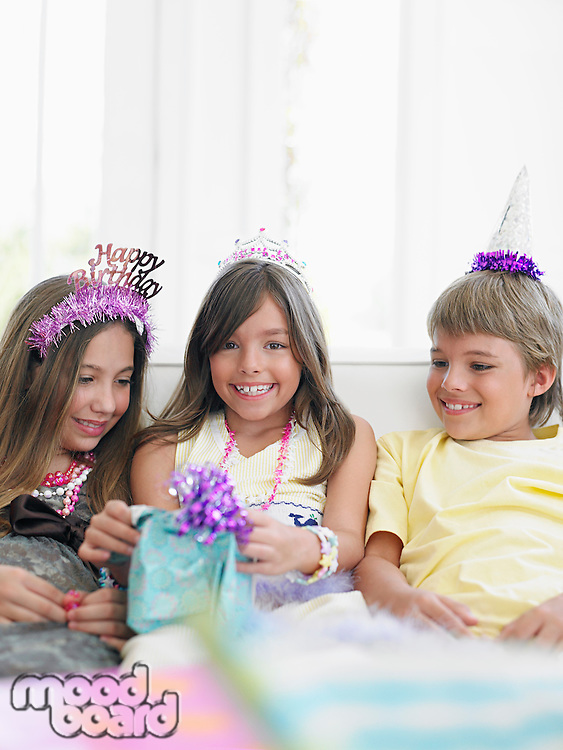 Children (7-12) at birthday party smiling