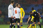 Giuseppe Bellusci of Leeds United confronts Bolton Wanderers midfielder Josh Vela following a challenge during the The FA Cup fourth round match between Bolton Wanderers and Leeds United at the Macron Stadium, Bolton, England on 30 January 2016. Photo by Simon Brady.