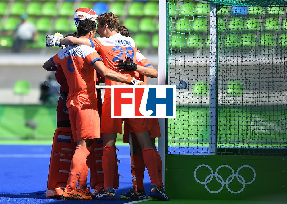 Netherland's players celebrate winning after the men's field hockey Netherland's vs India match of the Rio 2016 Olympics Games at the Olympic Hockey Centre in Rio de Janeiro on August, 11 2016. / AFP / MANAN VATSYAYANA        (Photo credit should read MANAN VATSYAYANA/AFP/Getty Images)