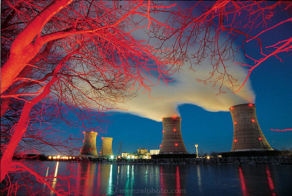"When the Three Mile Island reactor in Pennsylvania (no steam rising from the abandoned cooling towers on the left) failed catastrophically in 1979, the intense radioactivity in the plant prevented its owners from surveying and repairing the damage. Four years later, with conditions still unknown, Carnegie Mellon engineer William L. ""Red"" Whittaker designed several remote-controlled robots that were able to venture into the radioactive plant. From the book Robo sapiens: Evolution of a New Species, page 140."