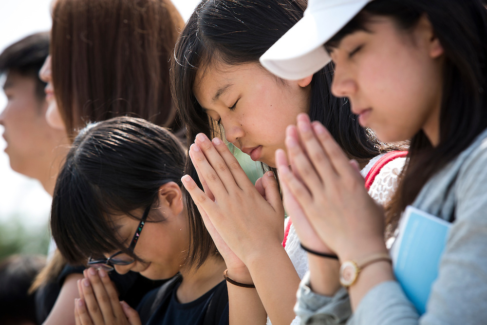 """HIROSHIMA, JAPAN - AUGUST 5 : Visitors pray for the atomic bomb victims in front of the cenotaph ahead of the 71st anniversary of the atomic bombing on Hiroshima at Hiroshima Peace Memorial Park in Hiroshima, western Japan, Friday, August 5, 2016. Japan marked the 71st anniversary of the atomic bombing on Hiroshima. On August 6, 1945, during World War II, the United States dropped a uranium gun-type atomic bomb named """"Little Boy"""" on the city of Hiroshima which instantly killed an estimated 80,000 people, tens of thousands more would later die of radiation exposure. Three days later, a second American B-29 bomber dropped a plutonium implosion-type bomb """"Fat Man"""" on Nagasaki, killing an estimated 40,000 people.  (Photo: Richard Atrero de Guzman/NURPhoto)"""