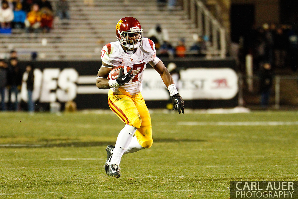 November 23rd, 2013: USC Trojans sophomore running back Javorius Allen (37) runs the ball in the third quarter of the NCAA Football game between the University of Southern California Trojans and the University of Colorado Buffaloes at Folsom Field in Boulder, Colorado