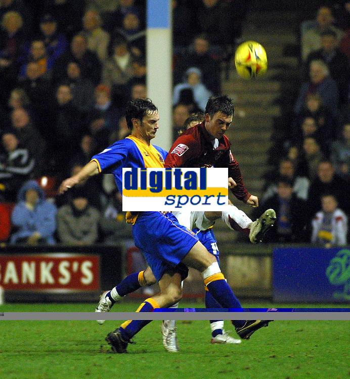 Photo: Dave Linney.<br />Walsall v Shrewsbury Town. Coca Cola League 2. 26/12/2006. Walsall's  Daniel Fox (R) clears the  ball as  Stuart Drummond  closes in.