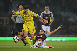 Cardiff City's Don Cowie is tackled by West Ham United's Ravel Morrison - Photo mandatory by-line: Mitchell Gunn/JMP - Tel: Mobile: 07966 386802 24/09/2013 - SPORT - FOOTBALL - Boleyn Ground - London - West Ham United V Cardiff City - Capital One Cup