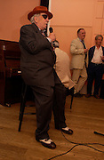 George Melly. Book launch of Take A Girl Like Me - Life With George by Diana Melly. The Polish Club. Exhibition Rd. London. 21 July 2005. ONE TIME USE ONLY - DO NOT ARCHIVE  © Copyright Photograph by Dafydd Jones 66 Stockwell Park Rd. London SW9 0DA Tel 020 7733 0108 www.dafjones.com