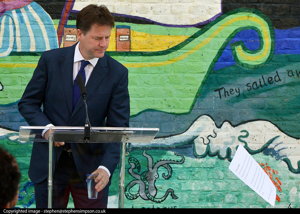 © Licensed to London News Pictures. 02/09/2013. Hammersmith, UK . Nick Cleggs speech is blown from the lectern by the wind. The Deputy Prime Minister, Nick Clegg, gives a speech on making Britain fit for modern families, including free childcare for two-year-olds. The government's two-year-old offer starts in September (15 hours per week of free childcare for those from the 20% most disadvantaged families, based on Free School Meals criteria). The Deputy Prime Minister set out how the offer is being extended from September 2014. . Photo credit : Stephen Simpson/LNP