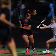 23 March 2018: San Diego State Aztecs attacker Elizabeth Rourke looks to pass the ball from behind the net in the first half. The Aztecs beat the Lady Flames 11-10 Friday night. <br /> More game action at sdsuaztecphotos.com