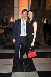 TOBY ROWLANDS and his wife PLUM SYKES at Hats - an antology of Stephen Jones held at the V&A, London on 23rd February 2009.
