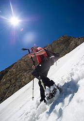THEMENBILD - Rutschgefahr bei Schneefeldern in den Alpen. Durch Altschneefelder und mangelnder Ausruestung bei Wanderern kommt es vermehrt zu Unfaellen beim Queren von Schneefeldern. Das Bild wurde am 16. Juli 2013 waehrend einer Tour in der Granatspitzgruppe aufgenommen. im Bild Wanderer rutscht ueber ein steiles Schneefeld // THEME IMAGE FEATURE - Danger of Slipping on Snowfields. The image was taken on july, 16th, 2013. Picture shows Mountaineer slips down a  Snwofield , AUT, EXPA Pictures © 2013, PhotoCredit: EXPA/ Michael Gruber