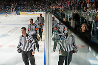 KELOWNA, CANADA - MAY 11: On ice officials line up during the national anthem on May 11, 2015 during game 3 of the WHL final series at Prospera Place in Kelowna, British Columbia, Canada.  (Photo by Marissa Baecker/Shoot the Breeze)  *** Local Caption *** referees; officials;