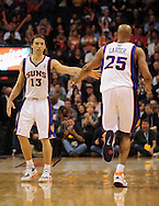 Feb. 17, 2011; Phoenix, AZ, USA; Phoenix Suns guard Steve Nash (13) and teammate Vince Carter (25) react on the court against the Dallas Mavericks at the US Airways Center. The Mavericks defeated the Suns 112-106. Mandatory Credit: Jennifer Stewart-US PRESSWIRE