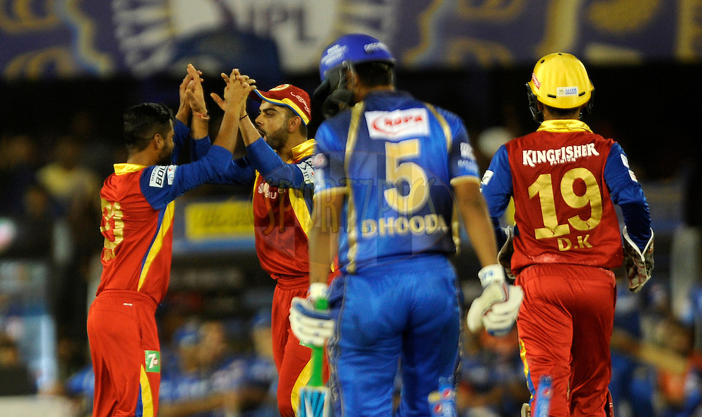 Virat Kohli captain of Royal Challengers Bangalore celebrates the wicket of Deepak Hooda of Rajasthan Royals during match 22 of the Pepsi IPL 2015 (Indian Premier League) between The Rajasthan Royals and The Royal Challengers Bangalore held at the Sardar Patel Stadium in Ahmedabad , India on the 24th April 2015.<br /> <br /> Photo by:  Pal Pillai / SPORTZPICS / IPL