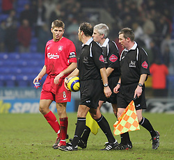 BOLTON, ENGLAND - MONDAY, JANUARY 2nd, 2006: Liverpool's captain Steven Gerrard chats with referee Mark Clattenburg after his side's 2-2 draw with Bolton Wanderers during the Premiership match at the Reebok Stadium. (Pic by David Rawcliffe/Propaganda)