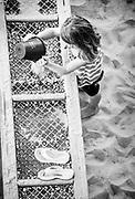 Sifting for sea shells in the sandbox at Ocean Isle Fish Company